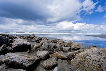 rocks water: Dramatic skies over he ocean in Ocean Shores, Washington. Stock Photo