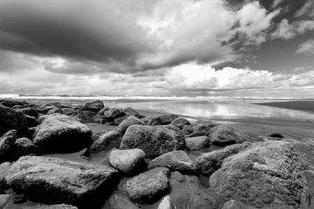shores: B&W of rocks by Pacific ocean at the south end of Ocean Shores, Washington. Stock Photo