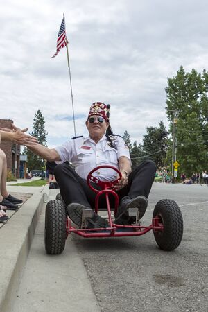 go kart: Rathdrum, Idaho USA - July 16, 2016. A member of Katif drives a go kart in the Rathdrum Days parade on July 16, 2016.