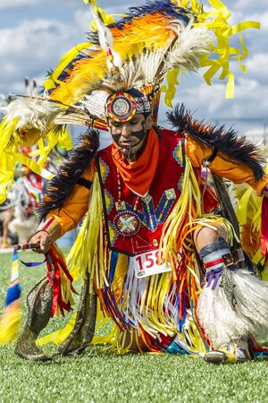 Coeur dAlene, Idaho USA - 07-23-2016. Close up of colorful traditional outfit. Young dancer participates in the Julyamsh Powwow on July 23, 2016 at the Kootenai County Fairgrounds in Coeur dAlene, Idaho. Editorial