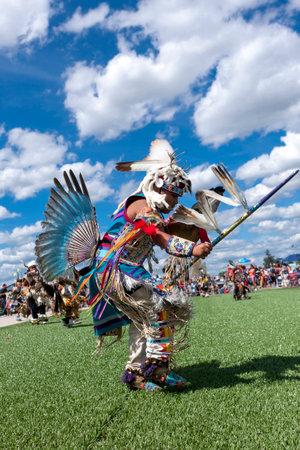 Coeur dAlene, Idaho USA - 07-23-2016. Ceremonial dance at Julyamsh powwow. Young dancer participates in the Julyamsh Powwow on July 23, 2016 at the Kootenai County Fairgrounds in Coeur dAlene, Idaho.
