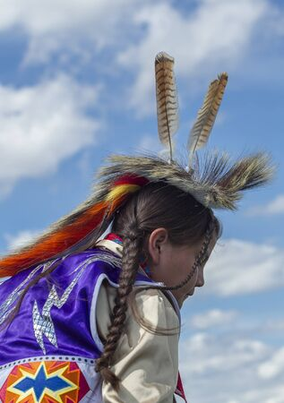 Coeur dAlene, Idaho USA - 07-23-2016. Feathers on the boys head. Young dancer participates in the Julyamsh Powwow on July 23, 2016 at the Kootenai County Fairgrounds in Coeur dAlene, Idaho. Editorial