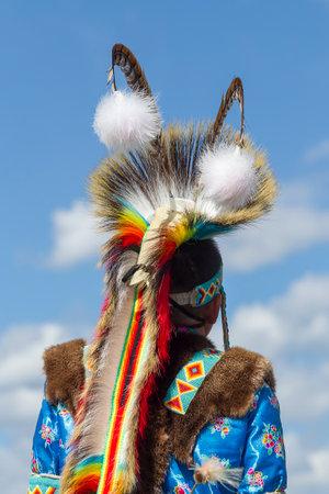 Coeur dAlene, Idaho USA - 07-23-2016. The back of a boys headdress. Young dancer participates in the Julyamsh Powwow on July 23, 2016 at the Kootenai County Fairgrounds in Coeur dAlene, Idaho.