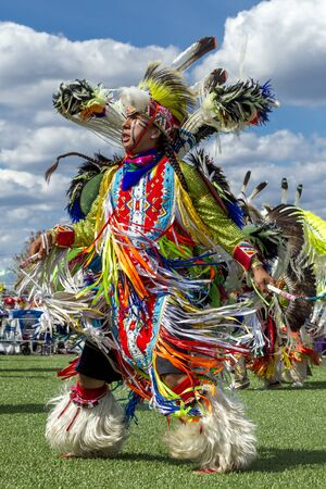 native american man: Coeur dAlene, Idaho USA - 07-23-2016. Native American man dancing at powwow. Young dancers participate in the Julyamsh Powwow on July 23, 2016 at the Kootenai County Fairgrounds in Coeur dAlene, Idaho.