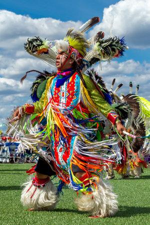 Coeur dAlene, Idaho USA - 07-23-2016. Native American man dancing at powwow. Young dancers participate in the Julyamsh Powwow on July 23, 2016 at the Kootenai County Fairgrounds in Coeur dAlene, Idaho.