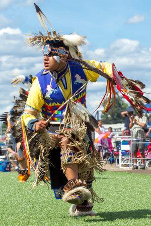 Coeur dAlene, Idaho USA - 07-23-2016. Man in competition powwow dance. Young dancer participates in the Julyamsh Powwow on July 23, 2016 at the Kootenai County Fairgrounds in Coeur dAlene, Idaho.