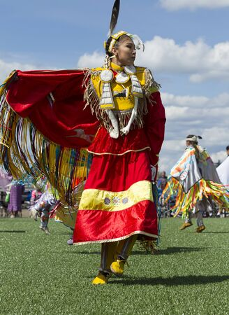 Coeur dAlene, Idaho USA - 07-23-2016. Young woman at Native American Powwow. Young dancer participates in the Julyamsh Powwow on July 23, 2016 at the Kootenai County Fairgrounds in Coeur dAlene, Idaho. Editorial
