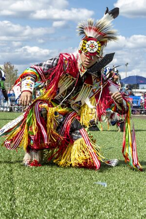 Coeur dAlene, Idaho USA - 07-23-2016. Tribal dance at powwow. Young dancer participates in the Julyamsh Powwow on July 23, 2016 at the Kootenai County Fairgrounds in Coeur dAlene, Idaho.