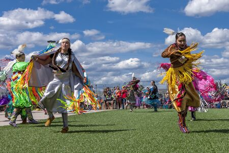 Coeur dAlene, Idaho USA - 07-23-2016. Two native American women at powwow. Young dancers participate in the Julyamsh Powwow on July 23, 2016 at the Kootenai County Fairgrounds in Coeur dAlene, Idaho.