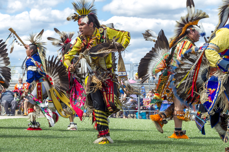 Coeur dAlene, Idaho USA - 07-23-2016. Male native American dancers at powwow. Young dancers participate in the Julyamsh Powwow on July 23, 2016 at the Kootenai County Fairgrounds in Coeur dAlene, Idaho.