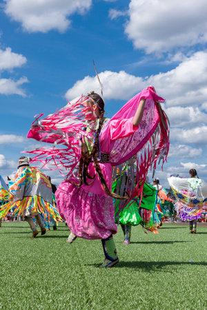Coeur dAlene, Idaho USA - 07-23-2016. Attractive Native American dress. Young dancer participates in the Julyamsh Powwow on July 23, 2016 at the Kootenai County Fairgrounds in Coeur dAlene, Idaho.