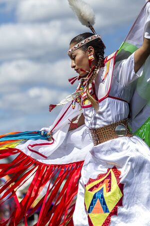 Coeur dAlene, Idaho USA - 07-23-2016. Sideview of beautiful Native American woman. Young dancer participates in the Julyamsh Powwow on July 23, 2016 at the Kootenai County Fairgrounds in Coeur dAlene, Idaho. Editorial