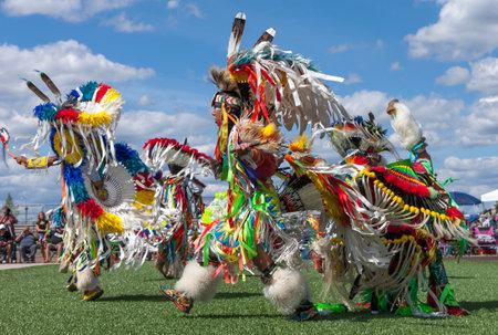 Coeur dAlene, Idaho USA - 07-23-2016. Native American men dancing at powwow. Young dancers participate in the Julyamsh Powwow on July 23, 2016 at the Kootenai County Fairgrounds in Coeur dAlene, Idaho. Editorial