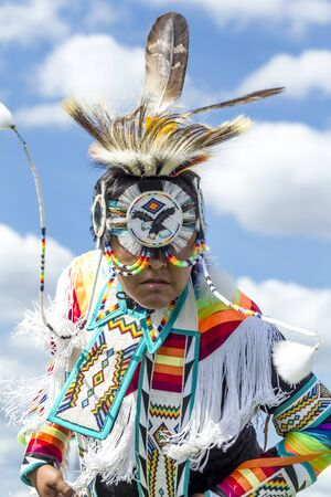 Coeur dAlene, Idaho USA - 07-23-2016. Close up of teen in native dress. Young dancer participates in the Julyamsh Powwow on July 23, 2016 at the Kootenai County Fairgrounds in Coeur dAlene, Idaho. Editorial