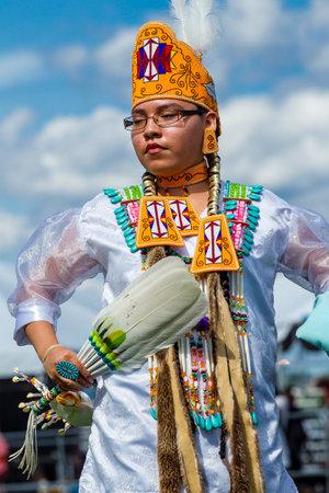 native american woman: Coeur dAlene, Idaho USA - 07-23-2016. Regal looking native American woman. Young dancer participates in the Julyamsh Powwow on July 23, 2016 at the Kootenai County Fairgrounds in Coeur dAlene, Idaho.