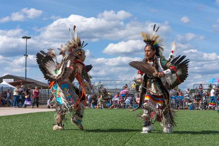 powwow: Coeur dAlene, Idaho USA - 07-23-2016. Opposing Native Americans at powwow dance. Young dancers participate in the Julyamsh Powwow on July 23, 2016 at the Kootenai County Fairgrounds in Coeur dAlene, Idaho.