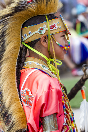 Coeur dAlene, Idaho USA - 07-23-2016. Side profile of Native American boy. Young dancer participates in the Julyamsh Powwow on July 23, 2016 at the Kootenai County Fairgrounds in Coeur dAlene, Idaho. Editorial