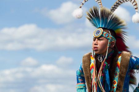 Coeur dAlene, Idaho USA - 07-23-2016. Native American youth. Young dancer participates in the Julyamsh Powwow on July 23, 2016 at the Kootenai County Fairgrounds in Coeur dAlene, Idaho.