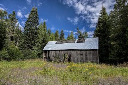 run down: An old run down abandoned barn in the countryside of north Idaho.