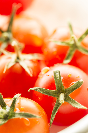 brightly lit: Brightly lit cherry tomatoes. Stock Photo