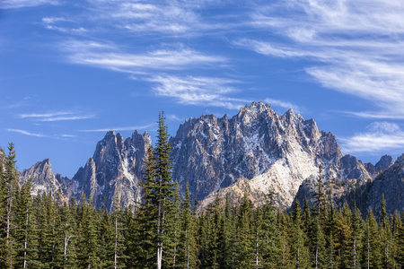 cascade range: Silver Star Ridge under a blue sky with streaking clouds along highway 20 in the Washington Cascades.
