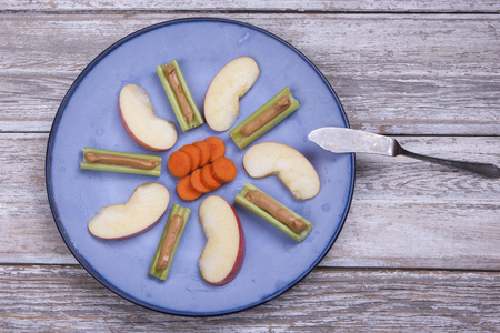 Carrots, apple slices and celery.
