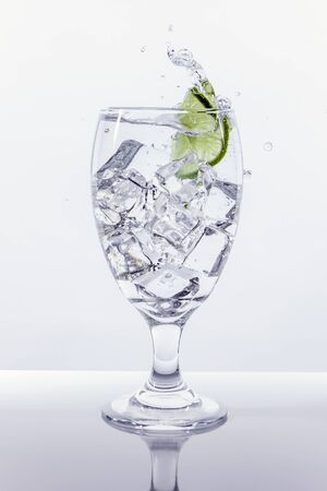 Lime splashes in water. Stock Photo