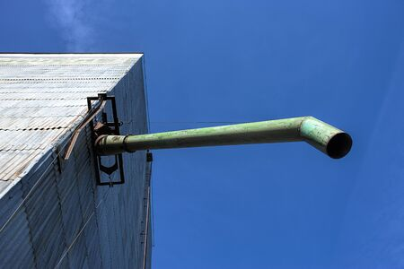 Looking up at a pipe from an old grainery in eastern Washington.