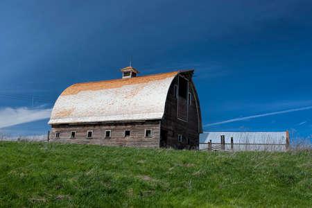 colfax: An old barn and green grass near Colfax, Washington.