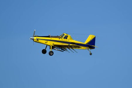 A small crop duster is flying in the sky near Spangle, Washington. Фото со стока