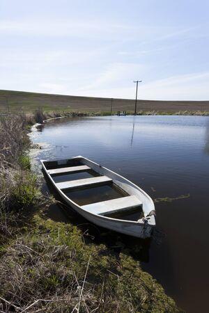 Row boat in a pond in eastern Washington.