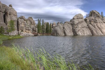Large rock pillars by the lake near Custer, South Dakota. Stock Photo