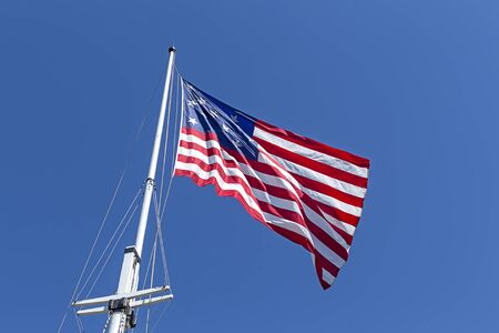 maryland flag: The great garrison flag, a replica of the 1812 flag, flies at Fort McHenry in Baltimore, Maryland. Stock Photo
