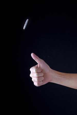 Concept image of flipping a coin up in the air.