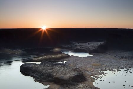 The beautiful sunrise over Dry Falls State Park near Coulee City, Washington.