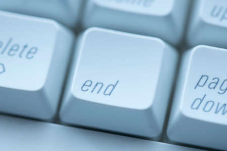 A conceptual close up photo of the end key on a keyboard.