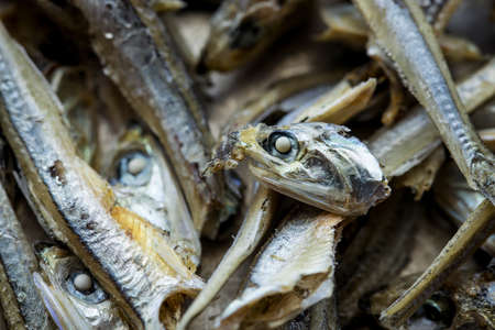 An overhead macro shot of dried anchovies in a pile.