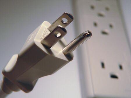 toma corriente: Plug Power y cable de extensi�n de salida  Foto de archivo