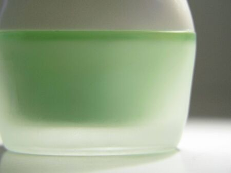 Green CreamLotion in Cosmetic Container
