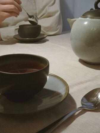stirring: Man stirring cup of tea