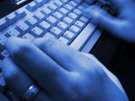 Blue toned man's hands typing quickly Stock Photo - 215285