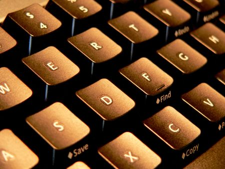 page down: Side-lit computer keyboard Stock Photo