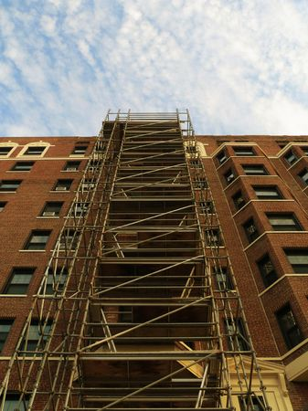 Scaffolding on Apartment Building Imagens
