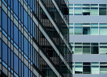 abstract composition featuring two modern office buildings photo