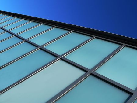 abstact: modern buidling detail against bright blue sky, abstact background