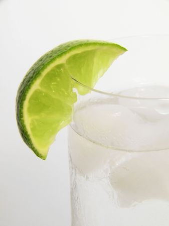 High Key lime wedge on chilled glass of gin and tonic