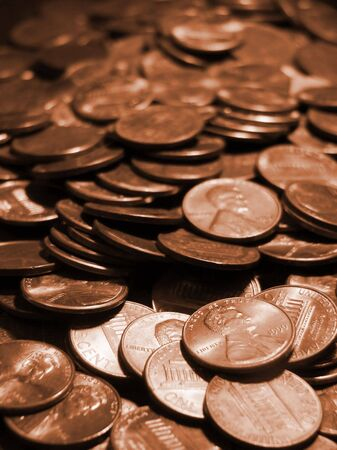 materialism: pile of copper pennies