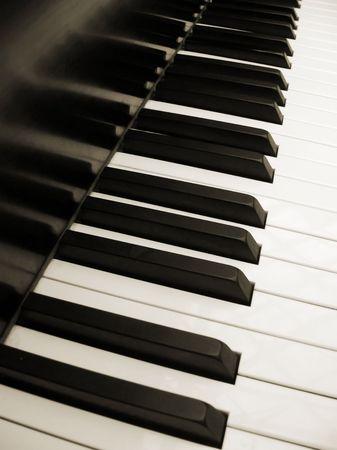 diagonal view of piano keys in sepia
