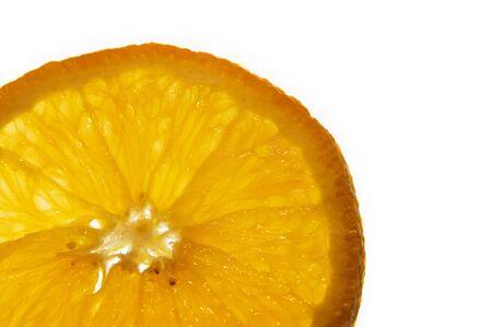 macro of an orange slice on white background