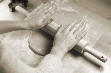 cooky: Womans hands rolling dough for cookies Stock Photo